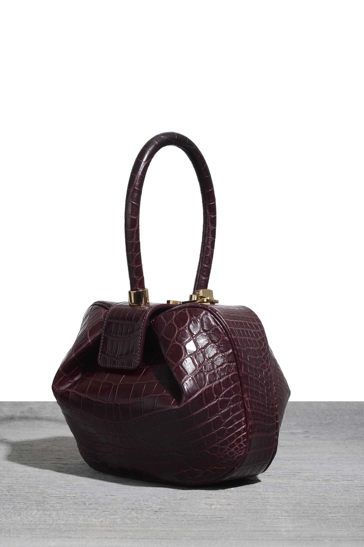 Nina bag in burgundy croc, $16,000, at Bergdorf Goodman and Net-a-Porter