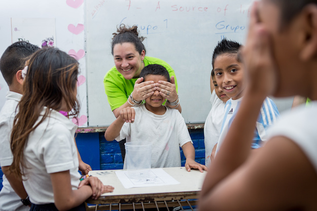 Co-founder Celina de Sola with a group of Glasswing children.