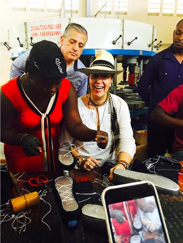 Founder Stephanie von Watzdorf with local artisans during a trip to Haiti.