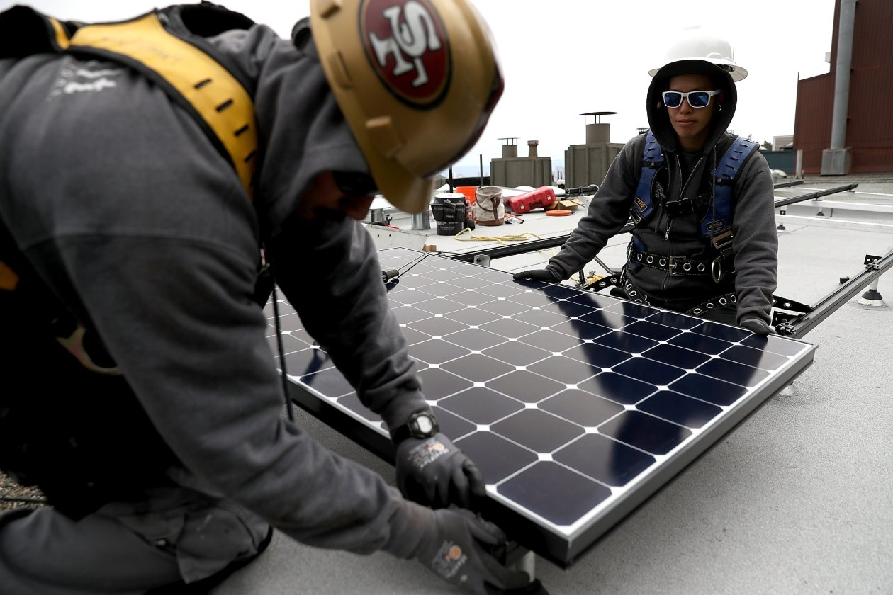 Solar panels being installed at a San Francisco home / Photo: Justin Sullivan/Getty Images.