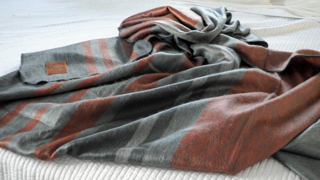 Equal Uprise alpaca blanket hand crafted in Ecuador.