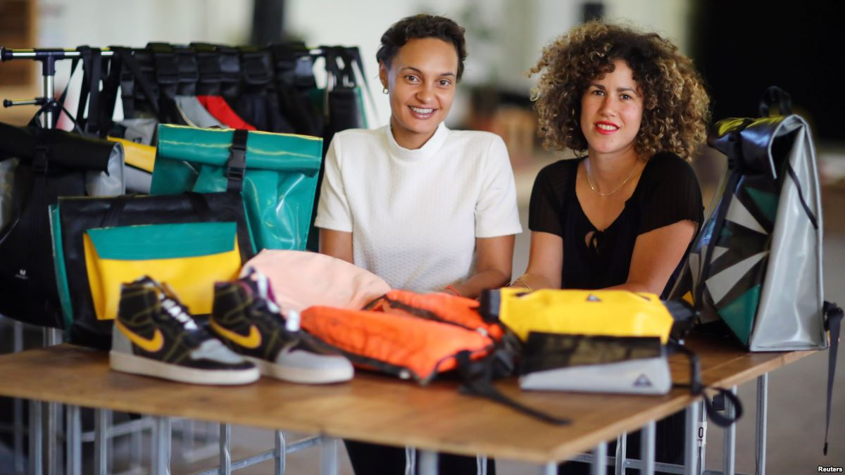 Nora Azzaoui and Vera G  ü  nther are the cofounders of Mimycri, a Berlin-based non-profit which recycles discarded dinghies into bags / Photo: Reuters.