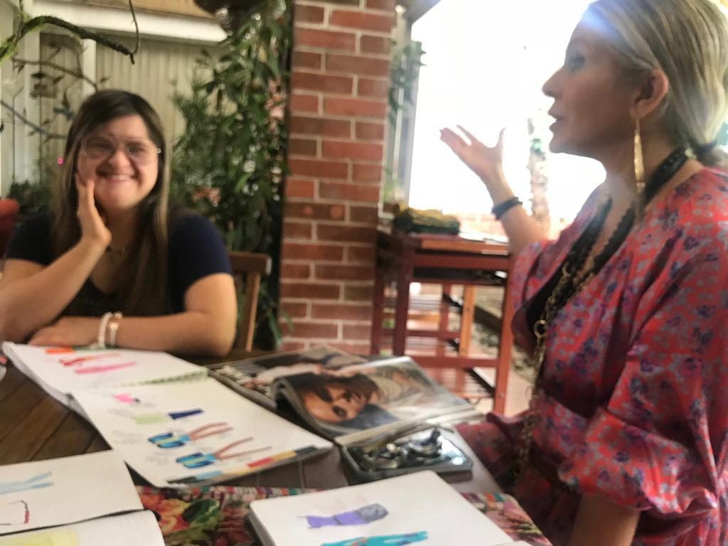 Carmen meets Isabella at her home in Guatemala City, and looks through her sketches.