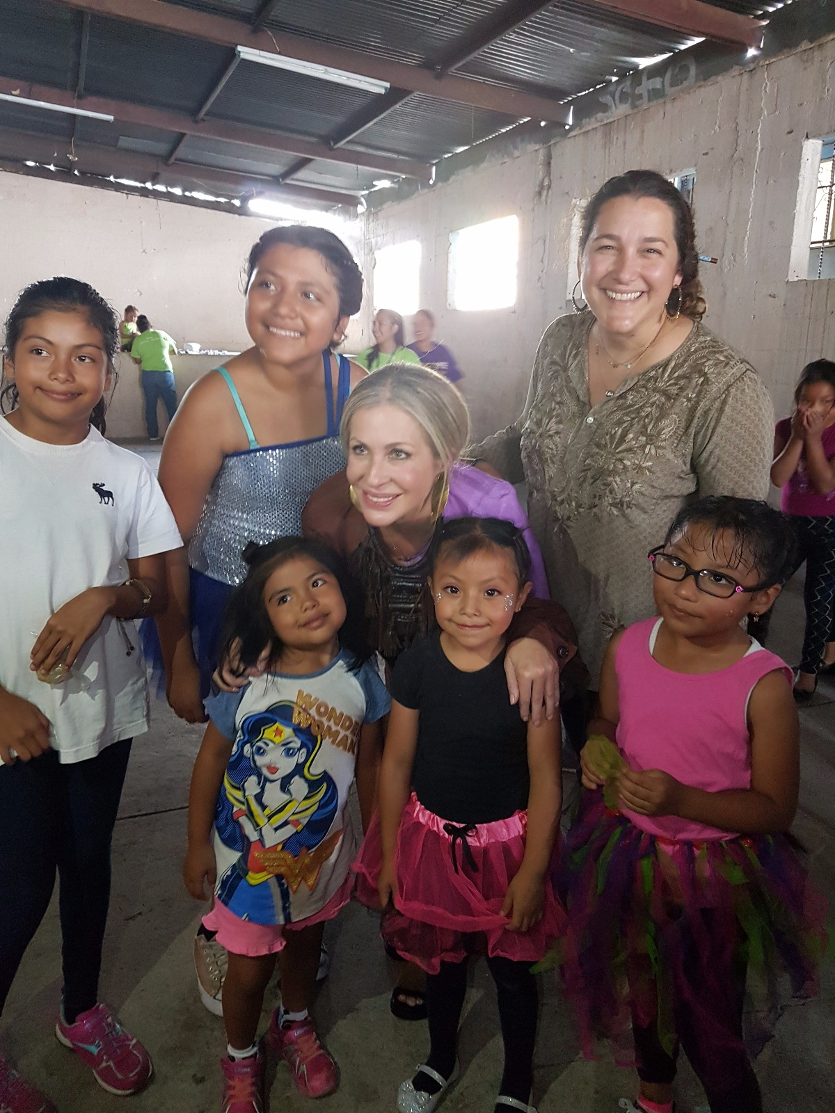 Carmen and Celina de Sola, co-founder and vice president of Glasswing International, with local schoolchildren in Guatemala.