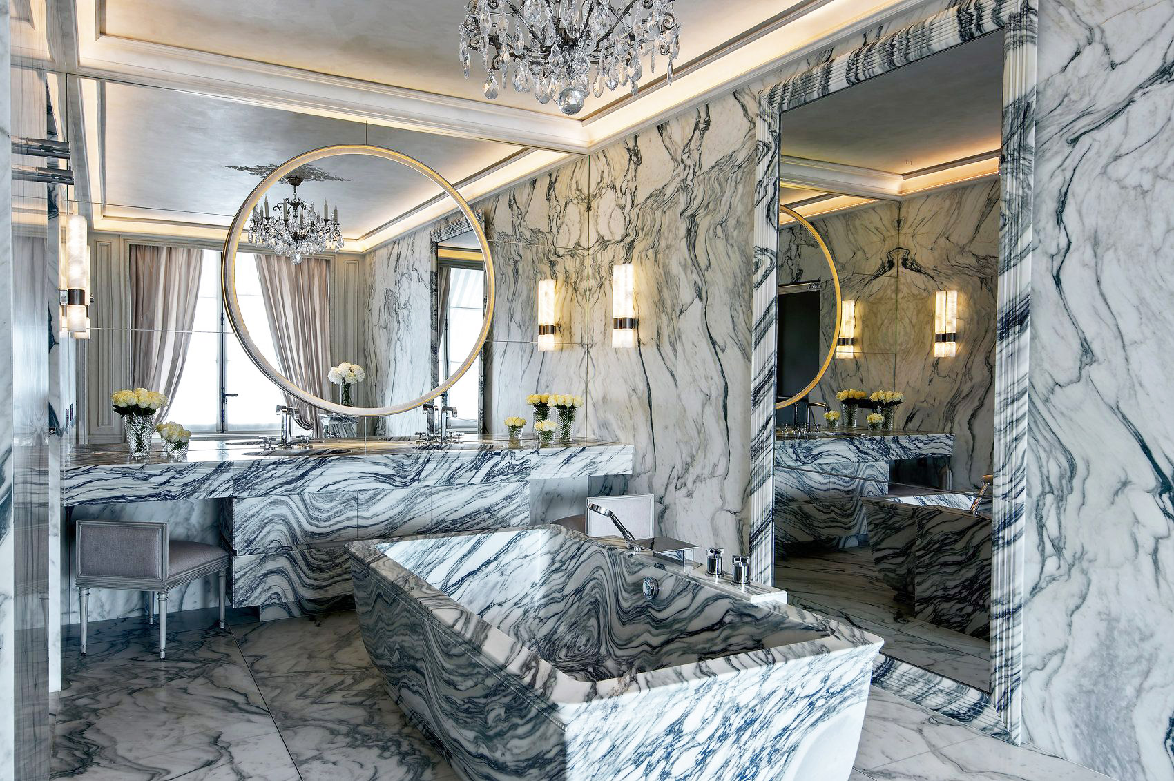 Each room in the residence offers stunning views of the Paris skyline, including from the Carrara marble bathtub.