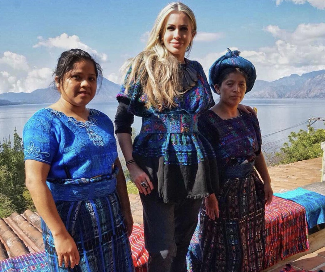 Carmen pictured with local artisans wearing traditional Mayan dress.