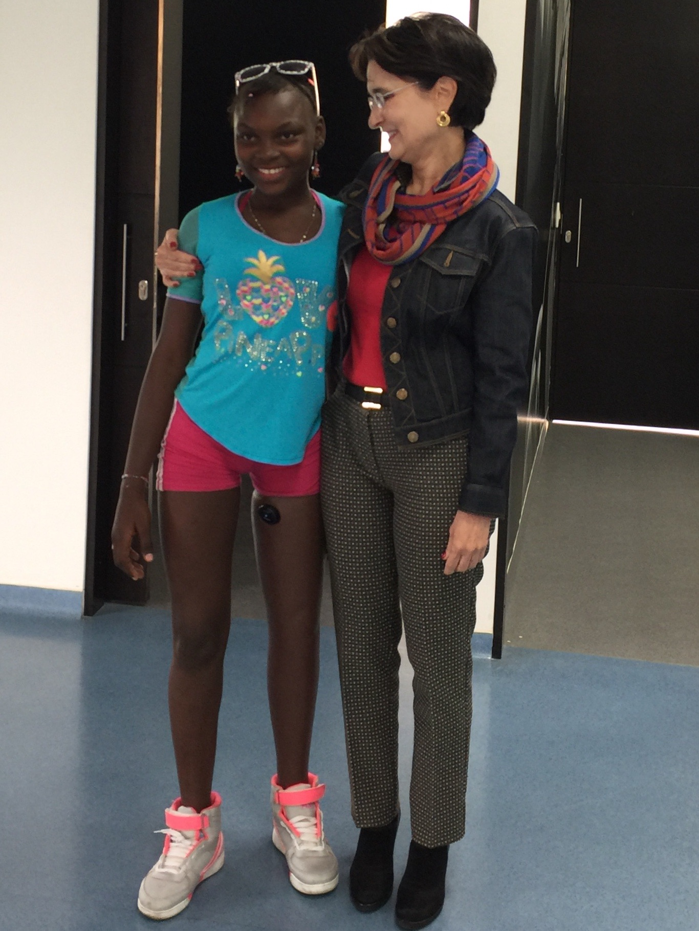 Gabriela Febres-Cordero with Lina Fernanda Angulo Congo, who lost her leg due to a stray bullet that reached her crib during a fight between the FARC and the military when she was just four months old.