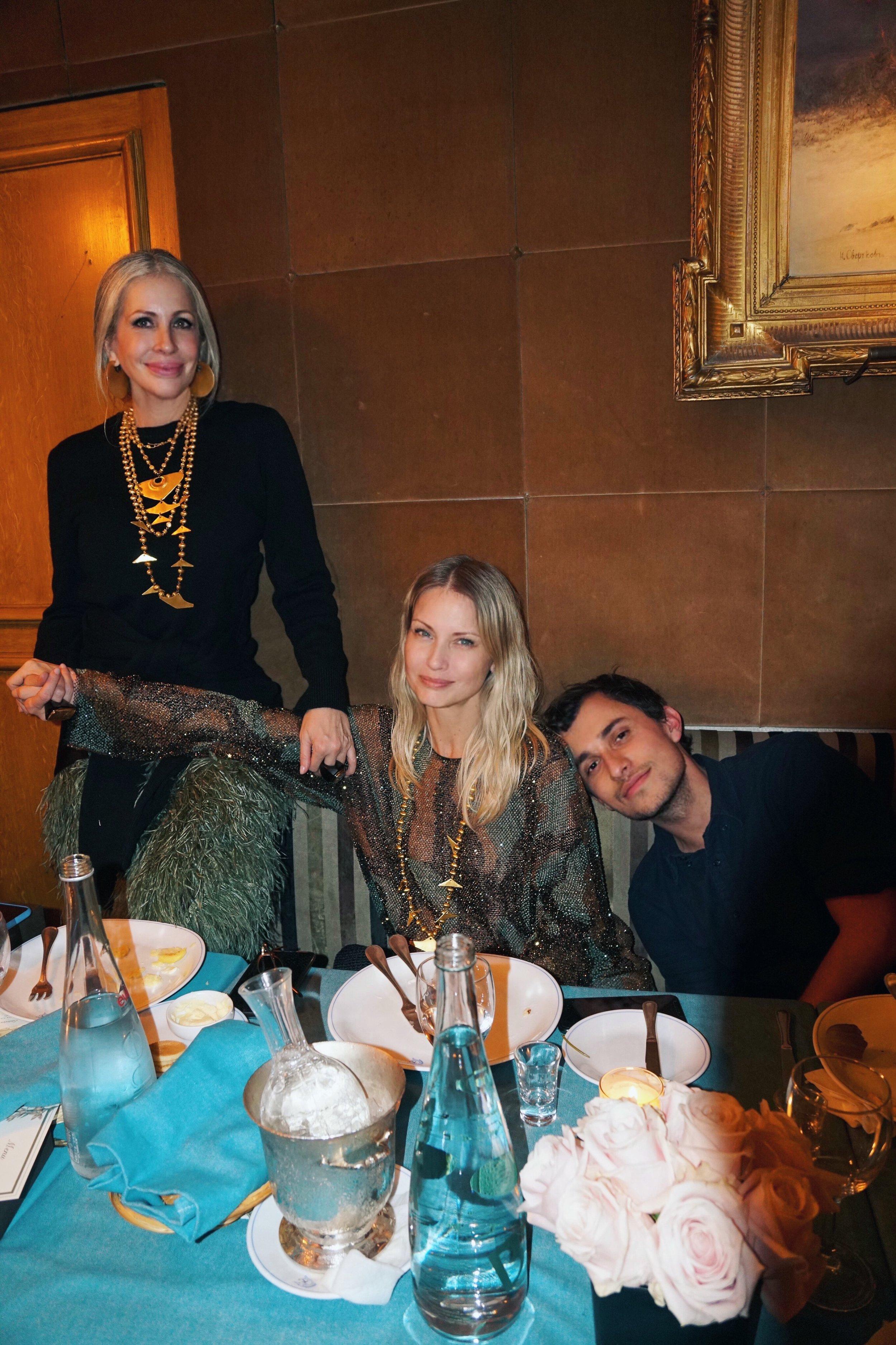 Carmen, Farfetch Chief Fashion Officer Holli Rogers, and designer Esteban Cortazar at Caviar Kaspia in Paris.