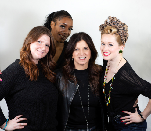 Glamsquad CEO Amy Shecter with three of the company's beauty professionals.