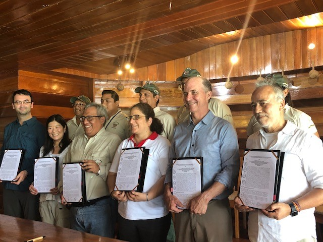 Key decision makers with the signed agreement in Peru.