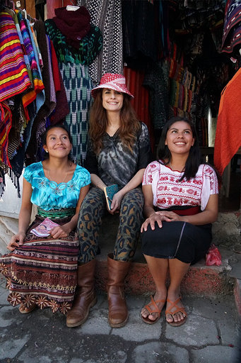 Eco-Age's Livia Firth with two local artisans.