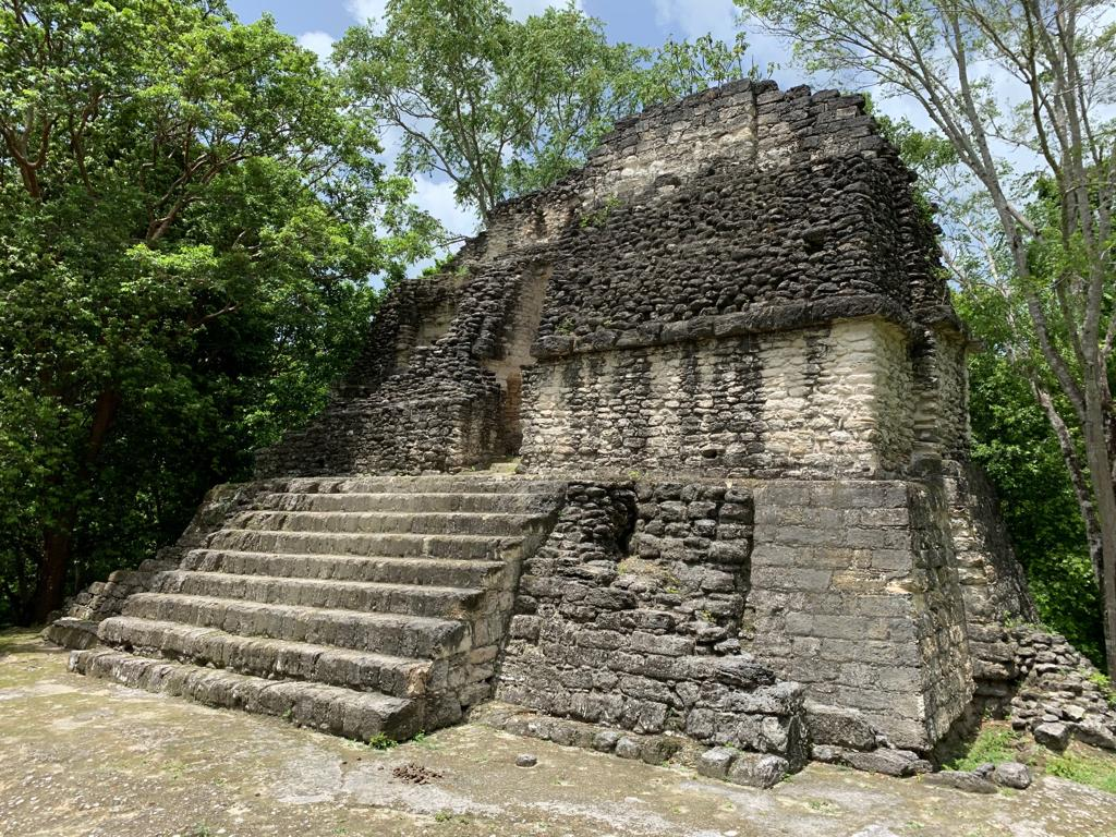The ruins in Uaxactun, 12 miles ( or 19 km) north of the major center of Tikal.