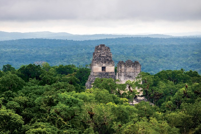 The pyramids at Tikal. The ground-breaking LiDAR survey has revealed just how much lies hidden under the forest canopy / Photo: Dreamstime/Diego Grandi.