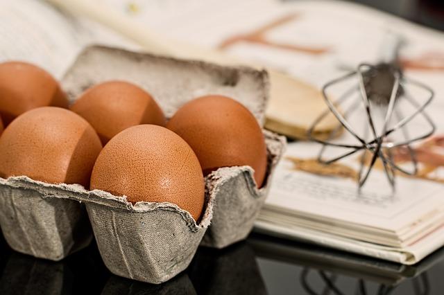 Dozen eggs whisk making Carrot Cake