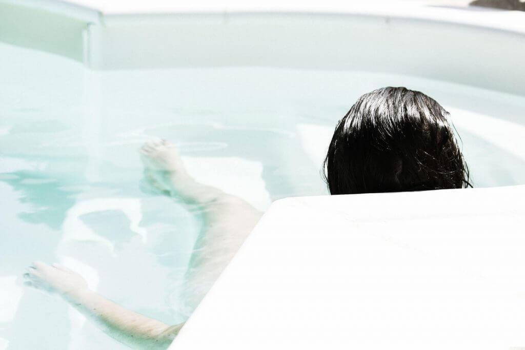 woman relaxing bath clear skin tips