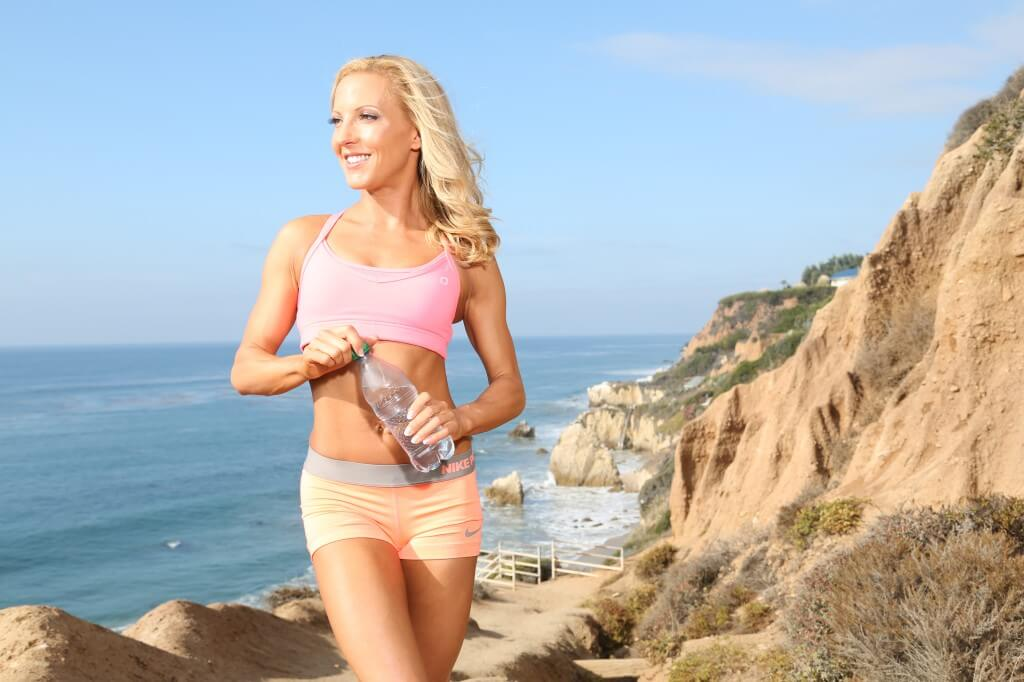 clear skin fitness model beach water bottle