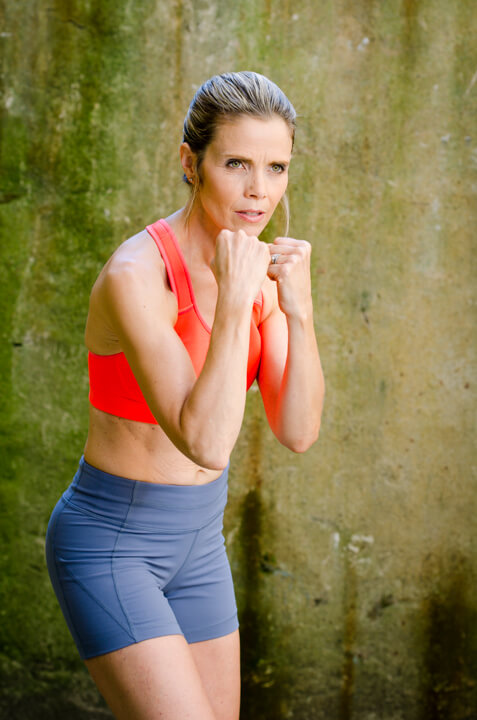self esteem activities boxing woman orange top