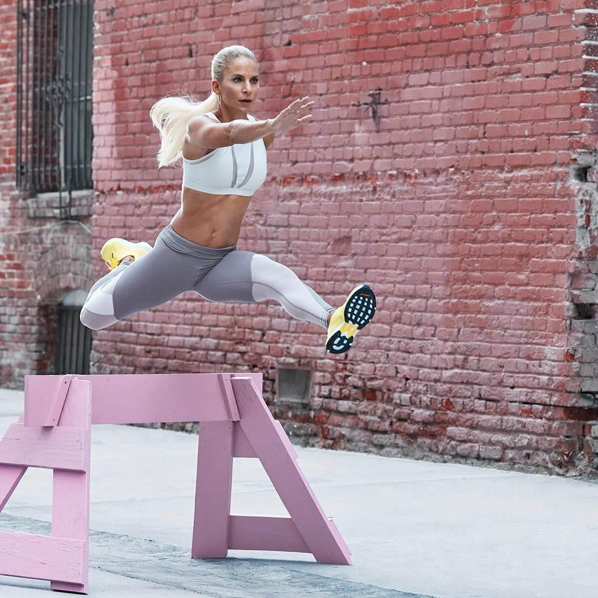 Fabletics reviews model jumping hurdles leggings sports bra