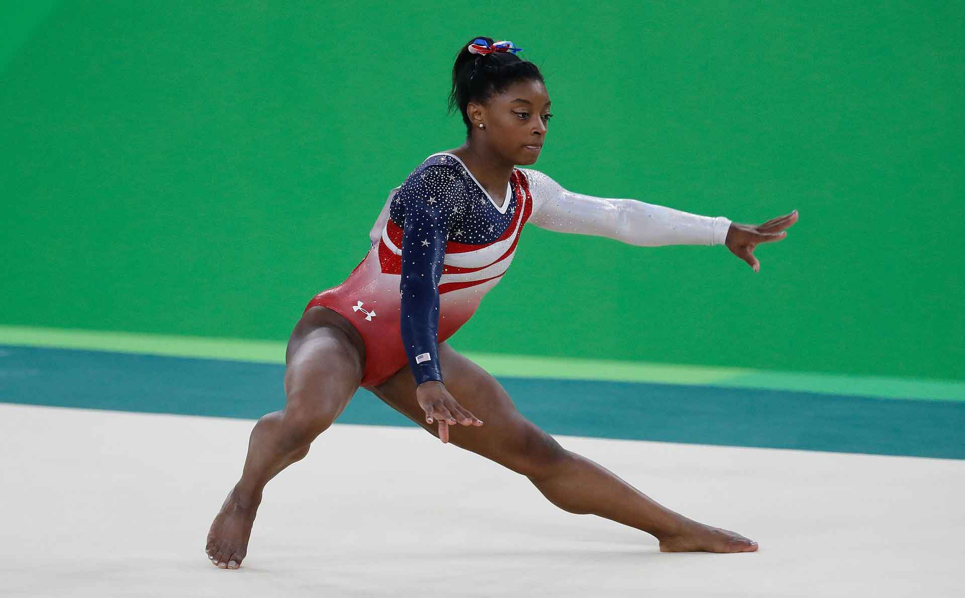 female athlete Simon Biles Olympic Gold Medal Gymnast