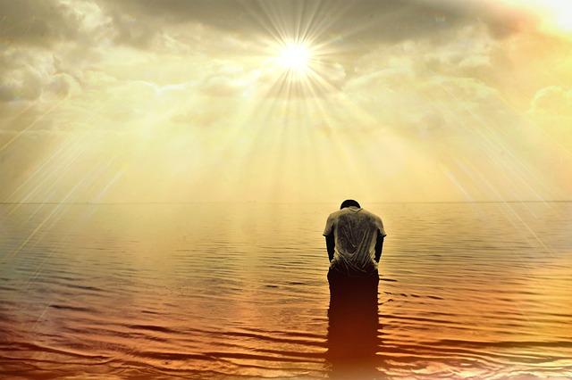 Man ocean sunset meditating