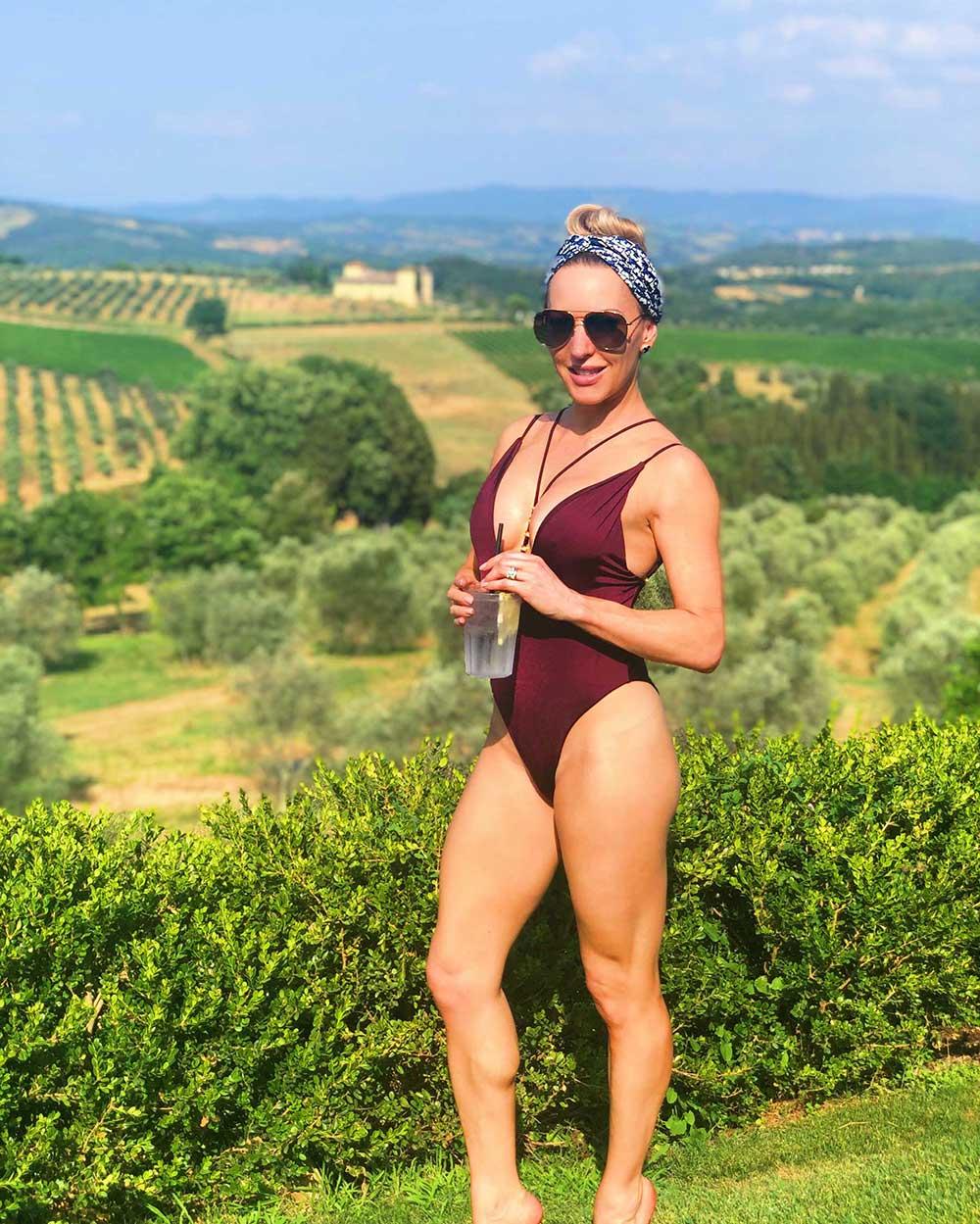 Luxury Travel Blogger Eve Dawes swimsuit poolside Como Castello del Nero Tuscany