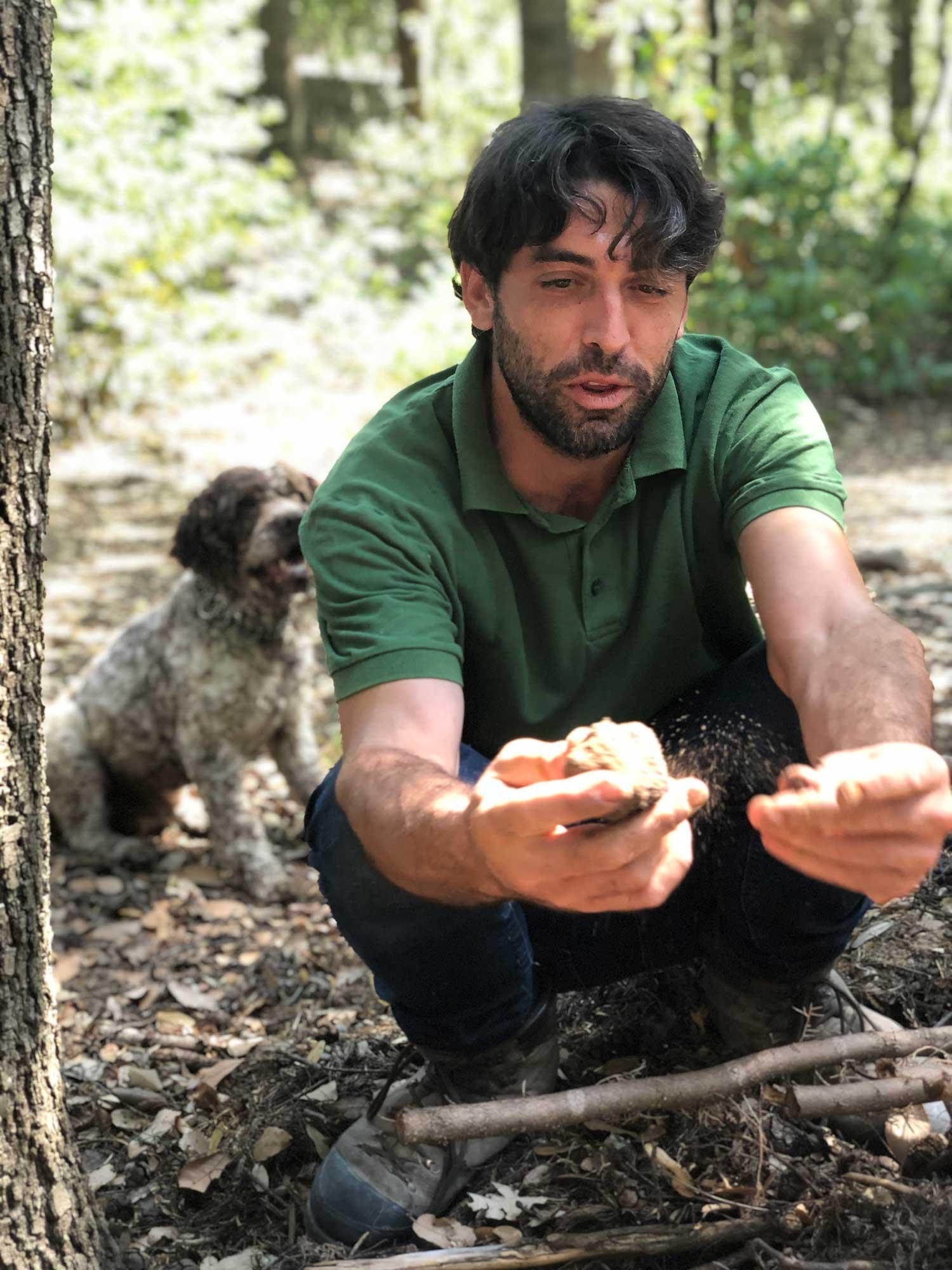 Truffle hunter Italian Truffle hunting dog finding truffles Tuscany tour