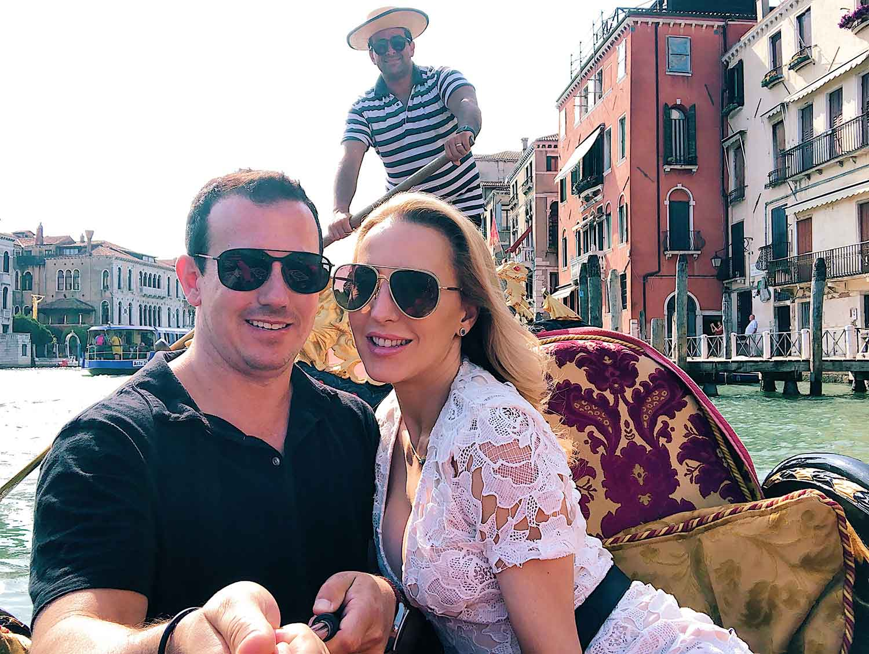 Luxury travel guide Vencie Italy Romantic couple Venice gondola ride grand canal