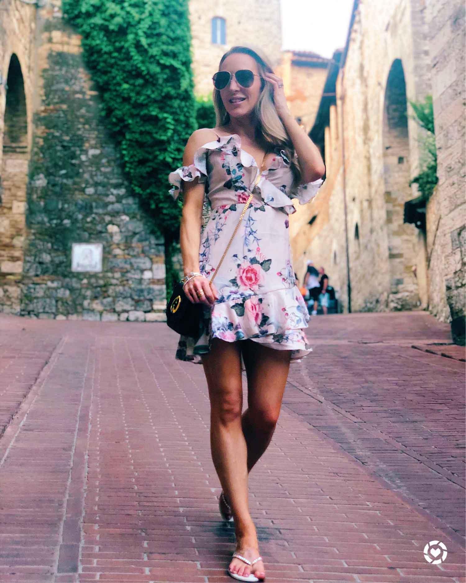 Enabled liketoknow.it dress influencer Eve Dawes walking Italy
