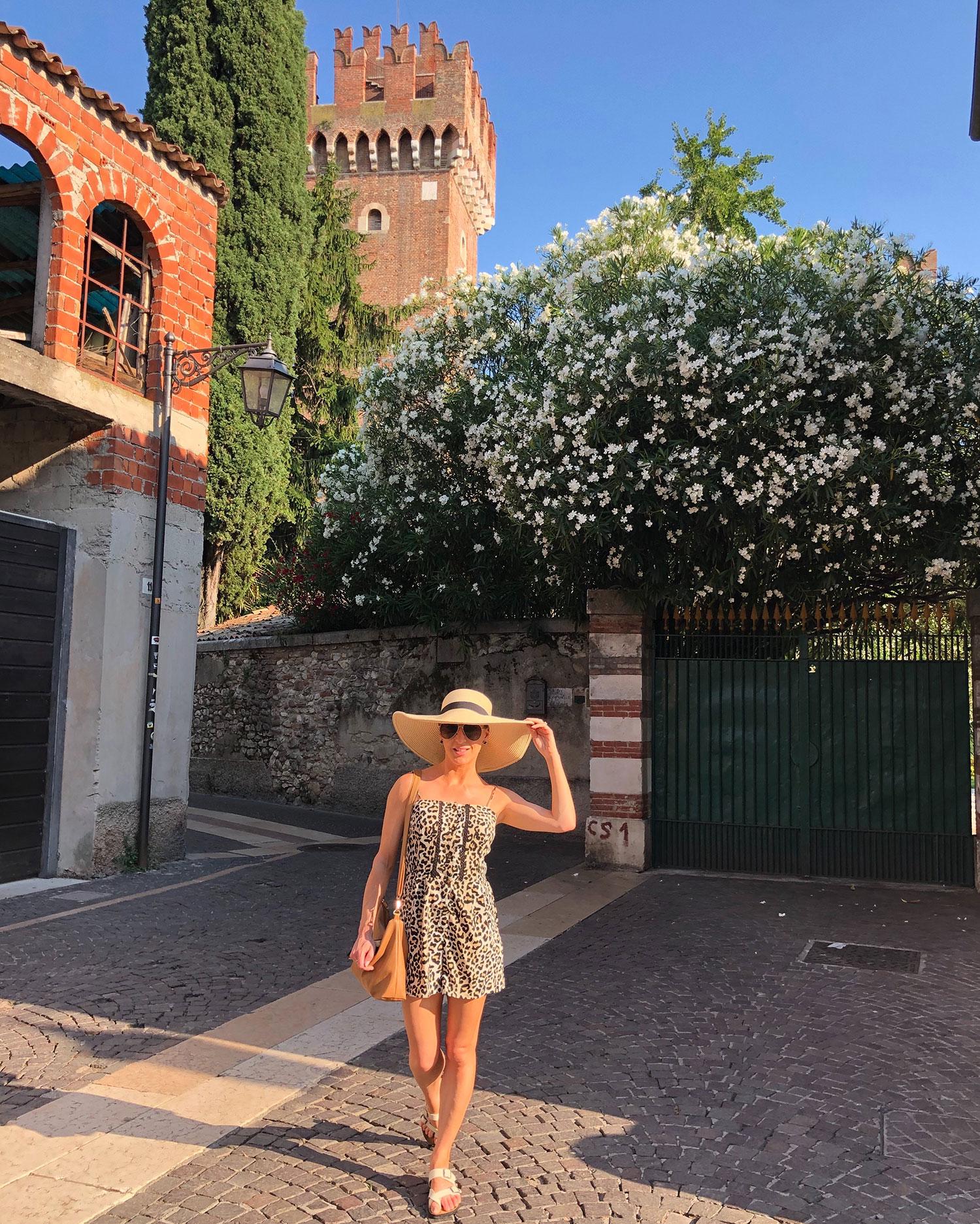Travel blogger Eve Dawes sunhat exploring Lazise Lake Garda Italy