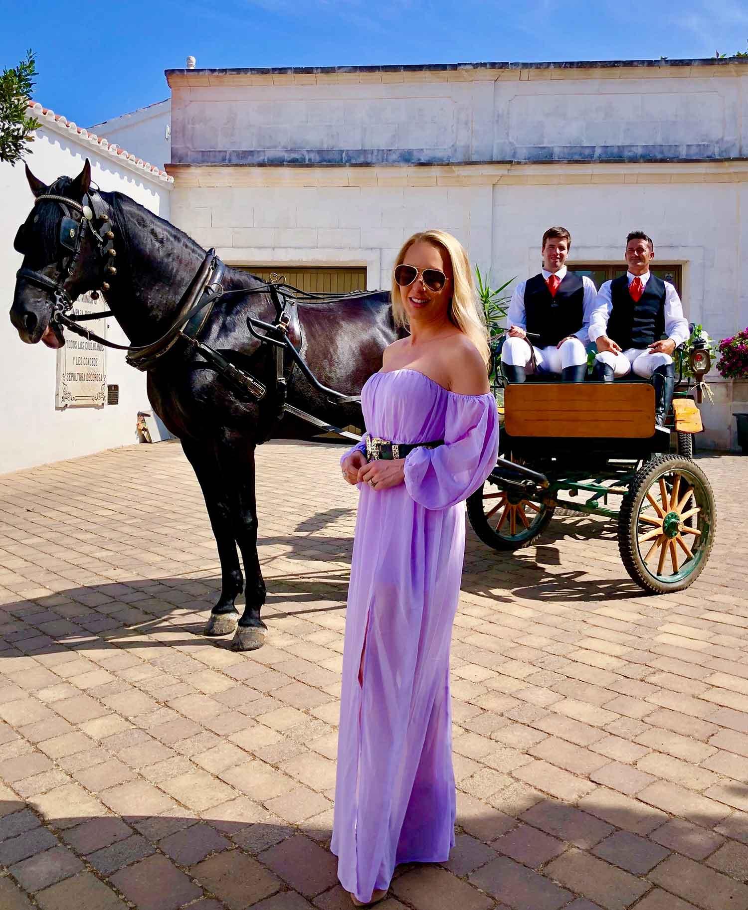 Luxury travel blogger Eve Dawes lilac dress horse carriage Menorca summer wedding