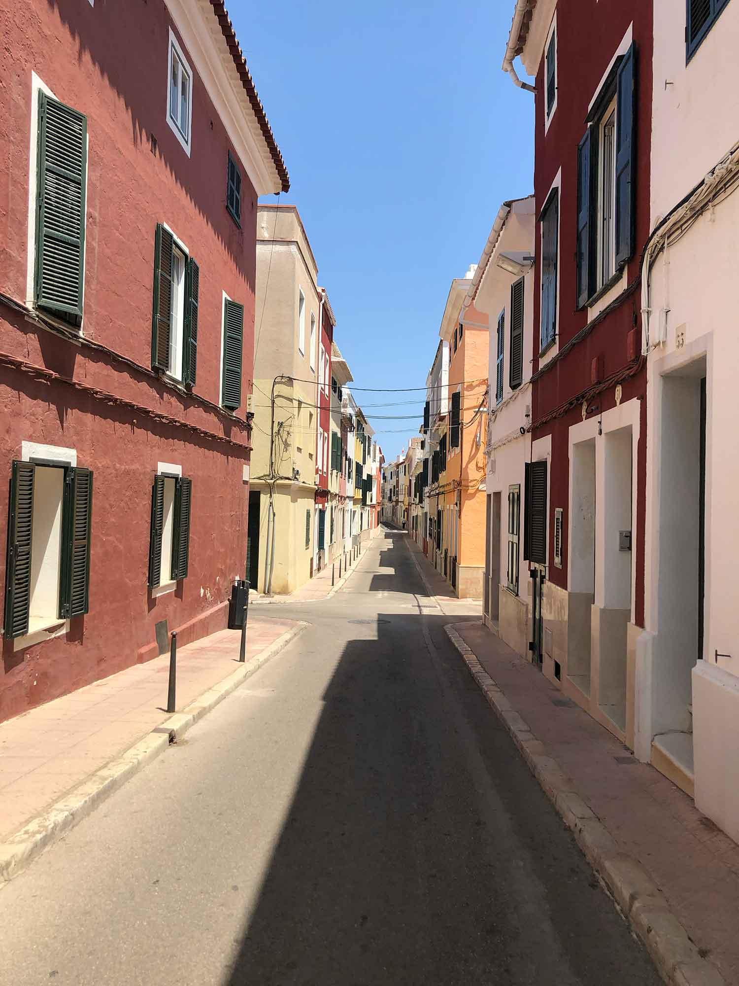 Narrow street traditional houses Mahon holiday