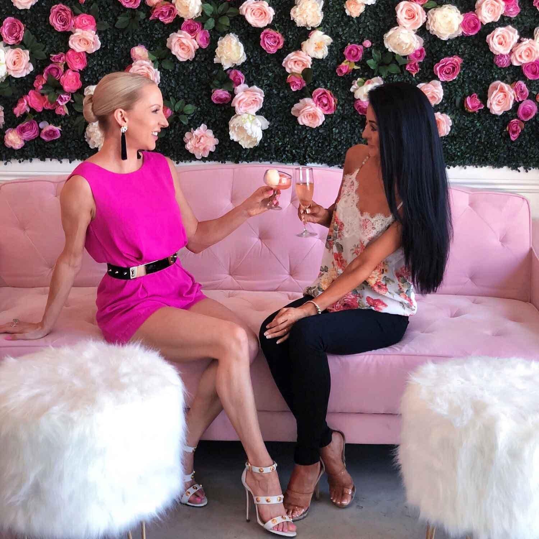 Cafe Lola Vegas girls drinking champagne pink sofa