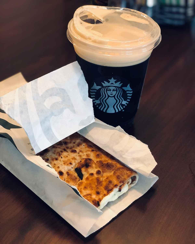 Business travel healthy breakfast Starbucks spinach egg white feta wrap black coffee