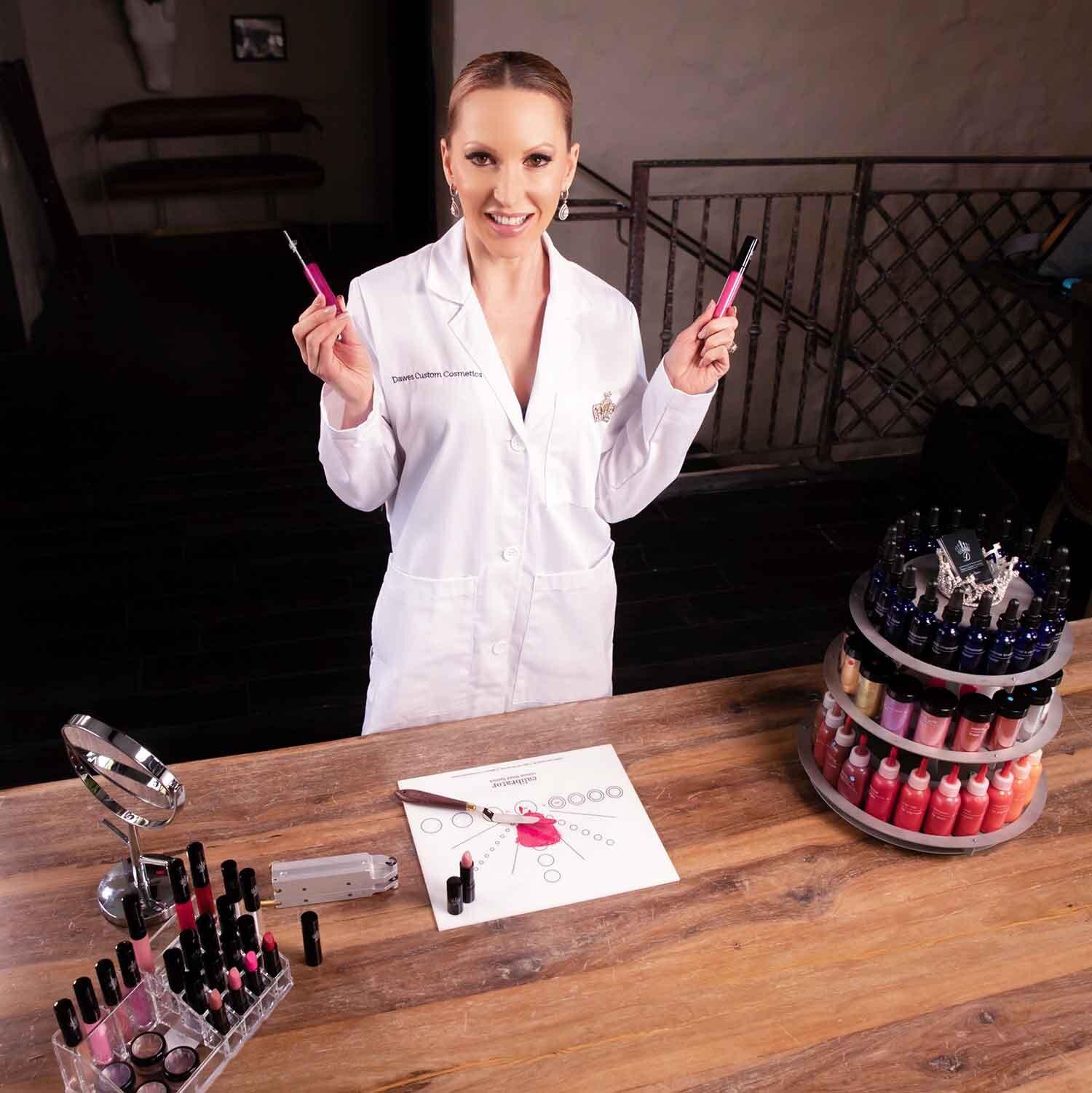Woman lab coat making lipstick with beauty gift set