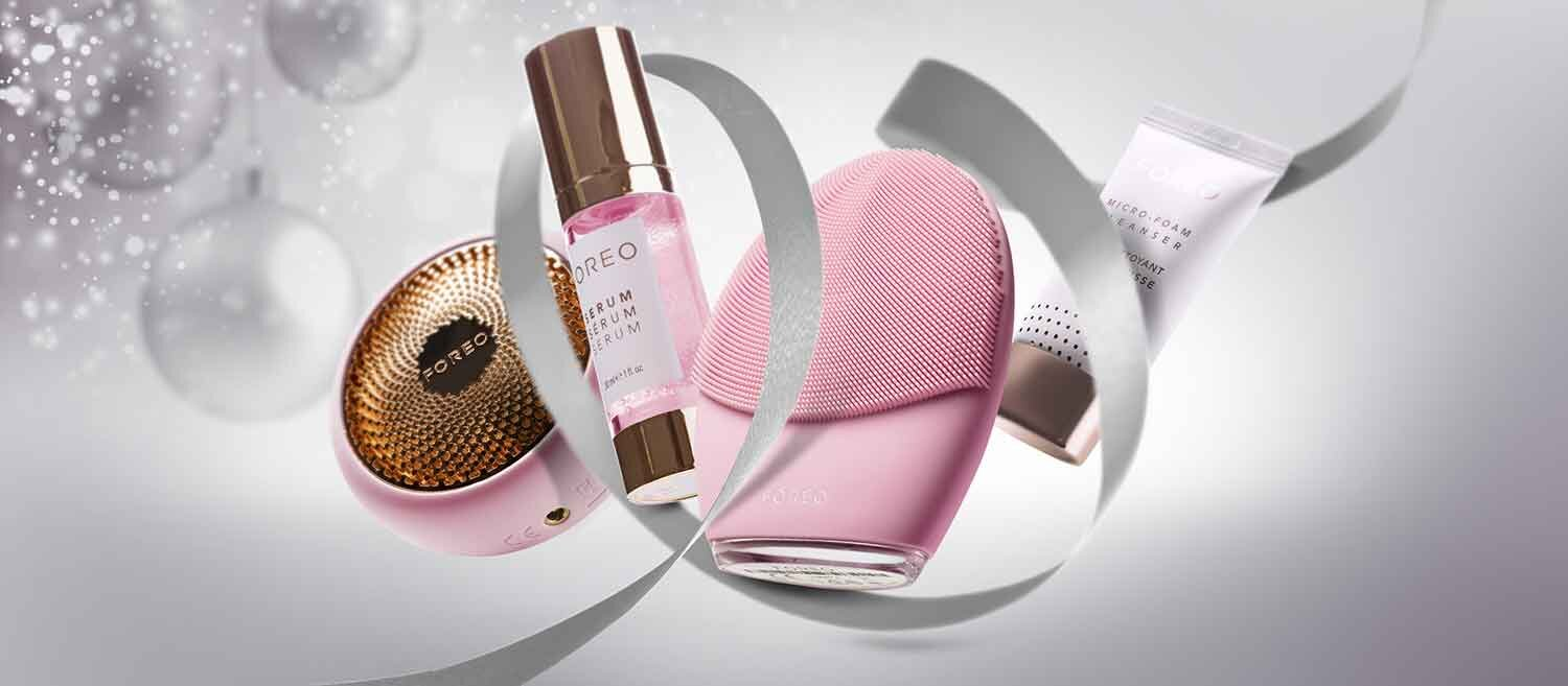 Foreo serum and pink Foreo cleansing device