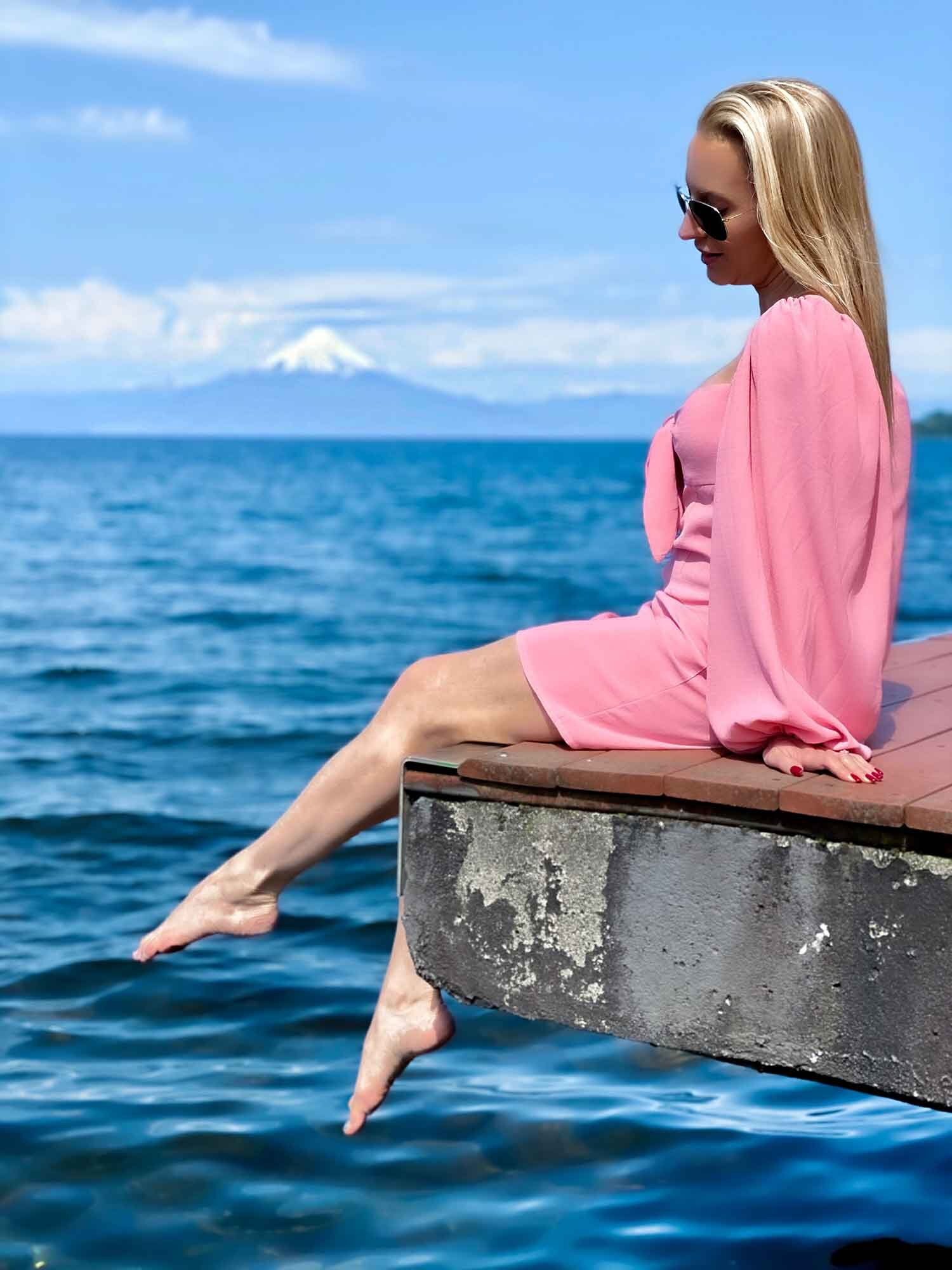 Fruitillar Lake District Chile Luxury travel blogger Eve Dawes sat pier over water