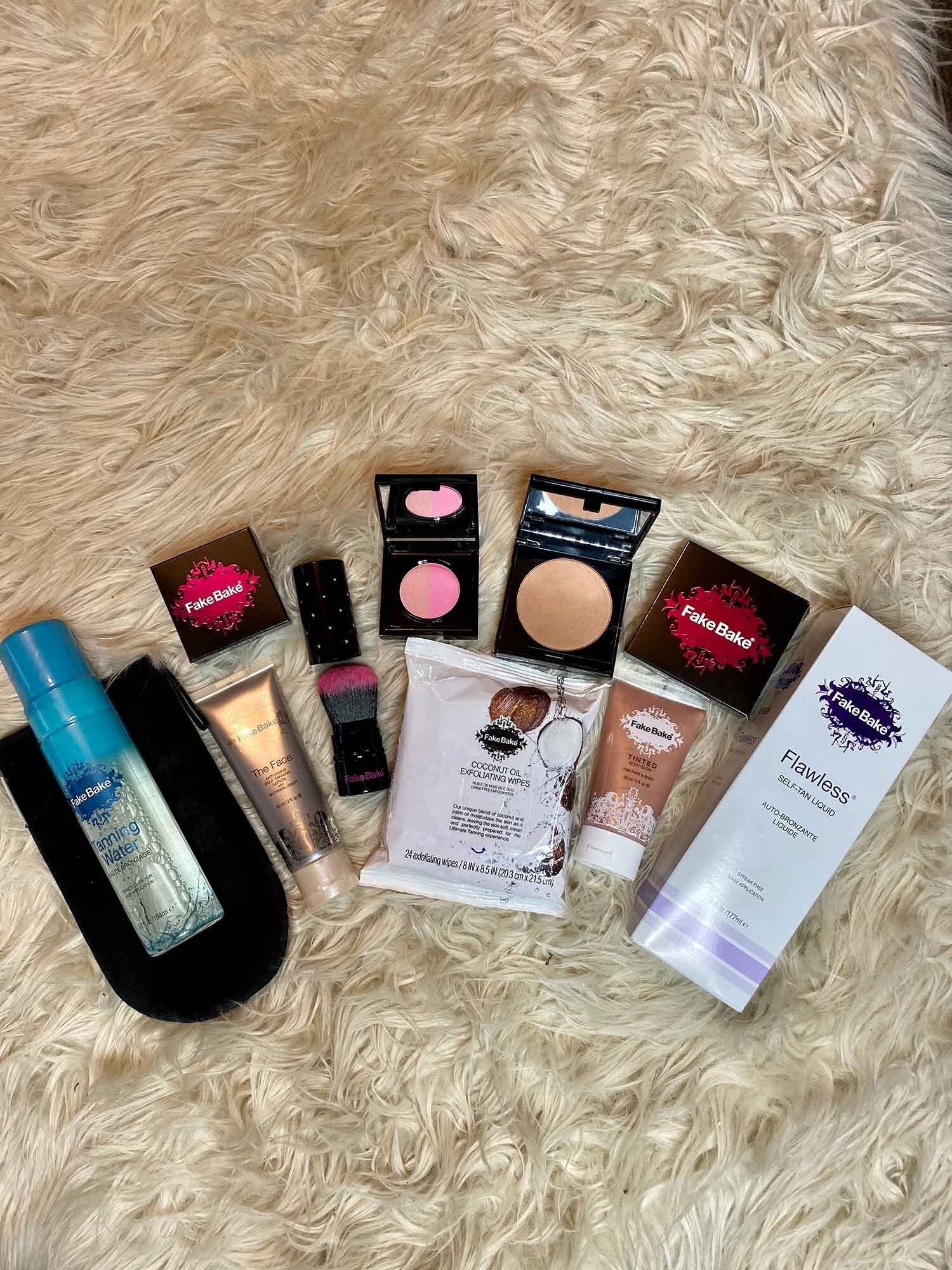 Fake bake tanning water and products on rug