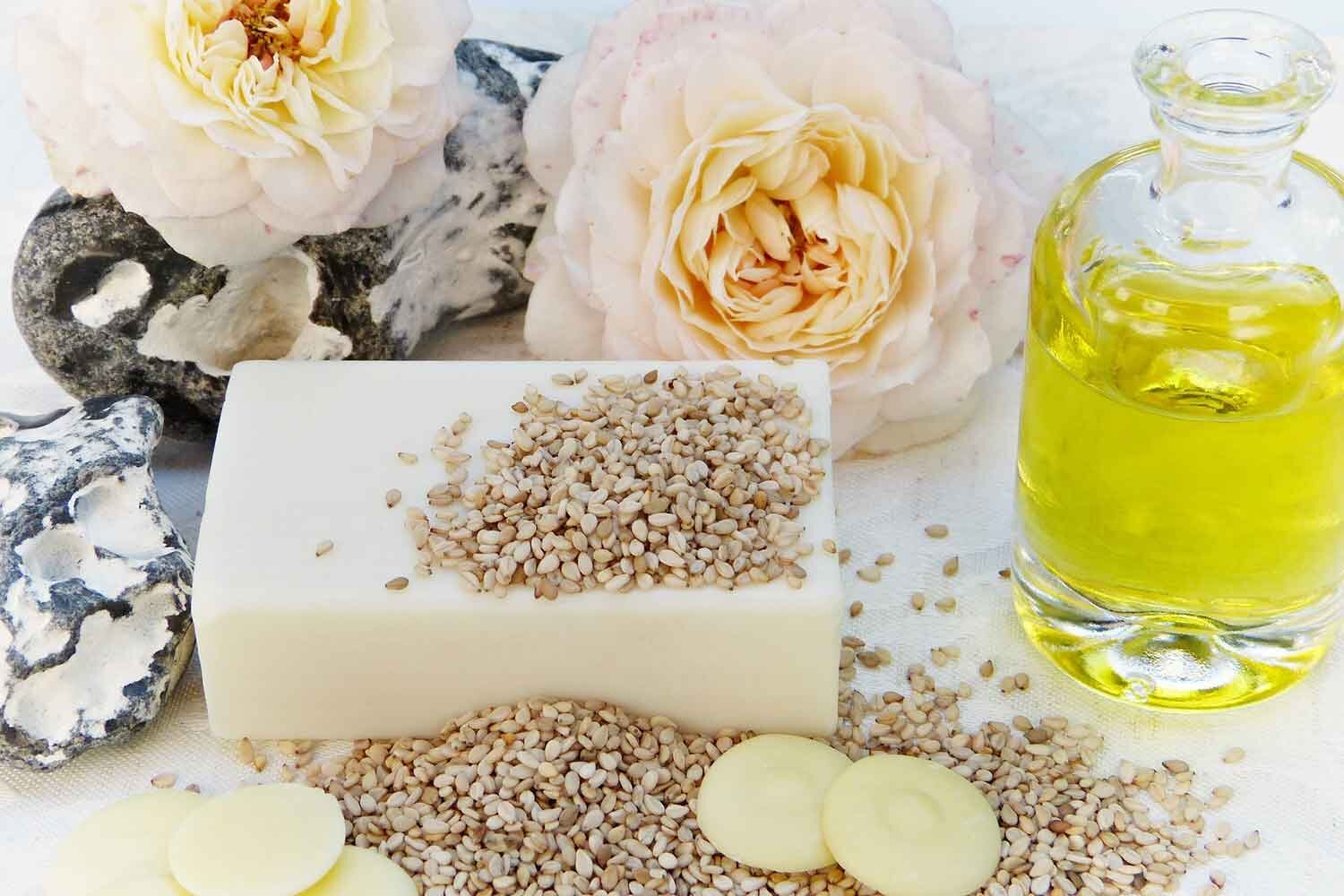 Clean beauty products soap, oil and flowers
