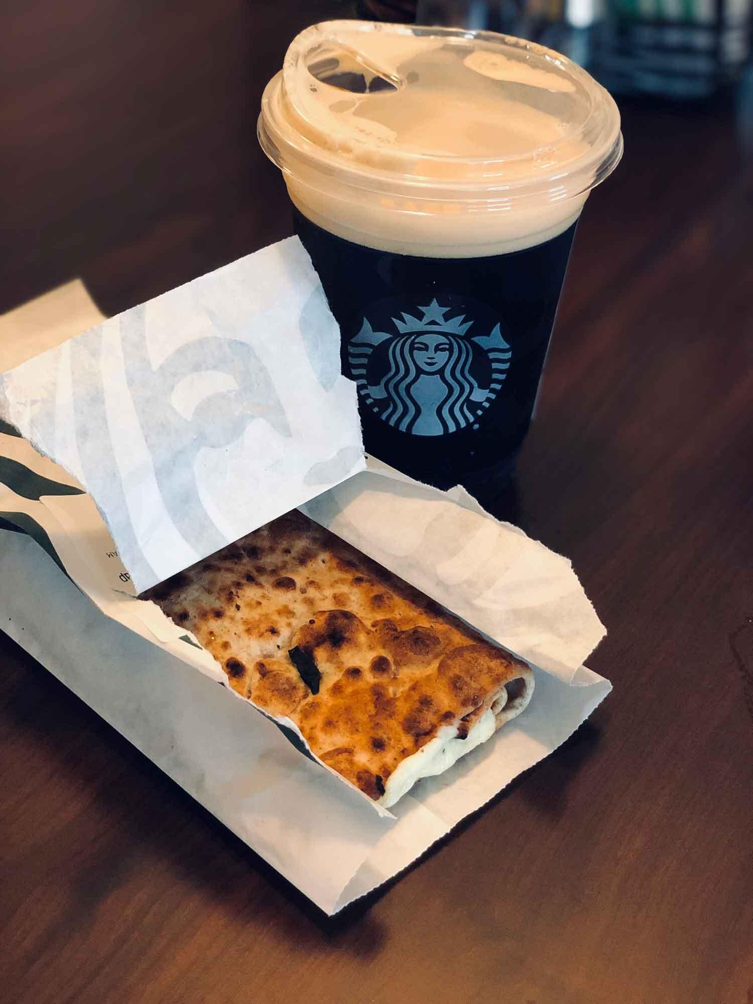 Healthy Starbucks breakfast spinach wrap and Nitro cold brew black coffee