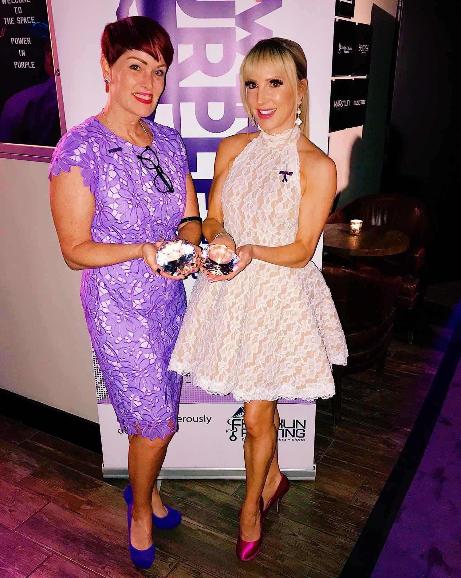 Hairdresser Andeen Clark and Fitness model Eve Dawes receiving awards