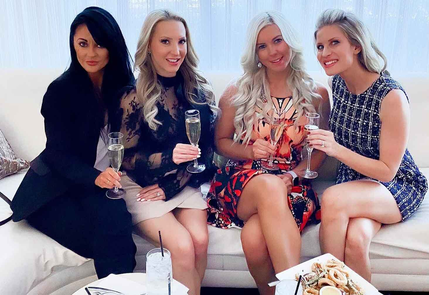Business casual fashion blogger Eve Dawes and friends champagne