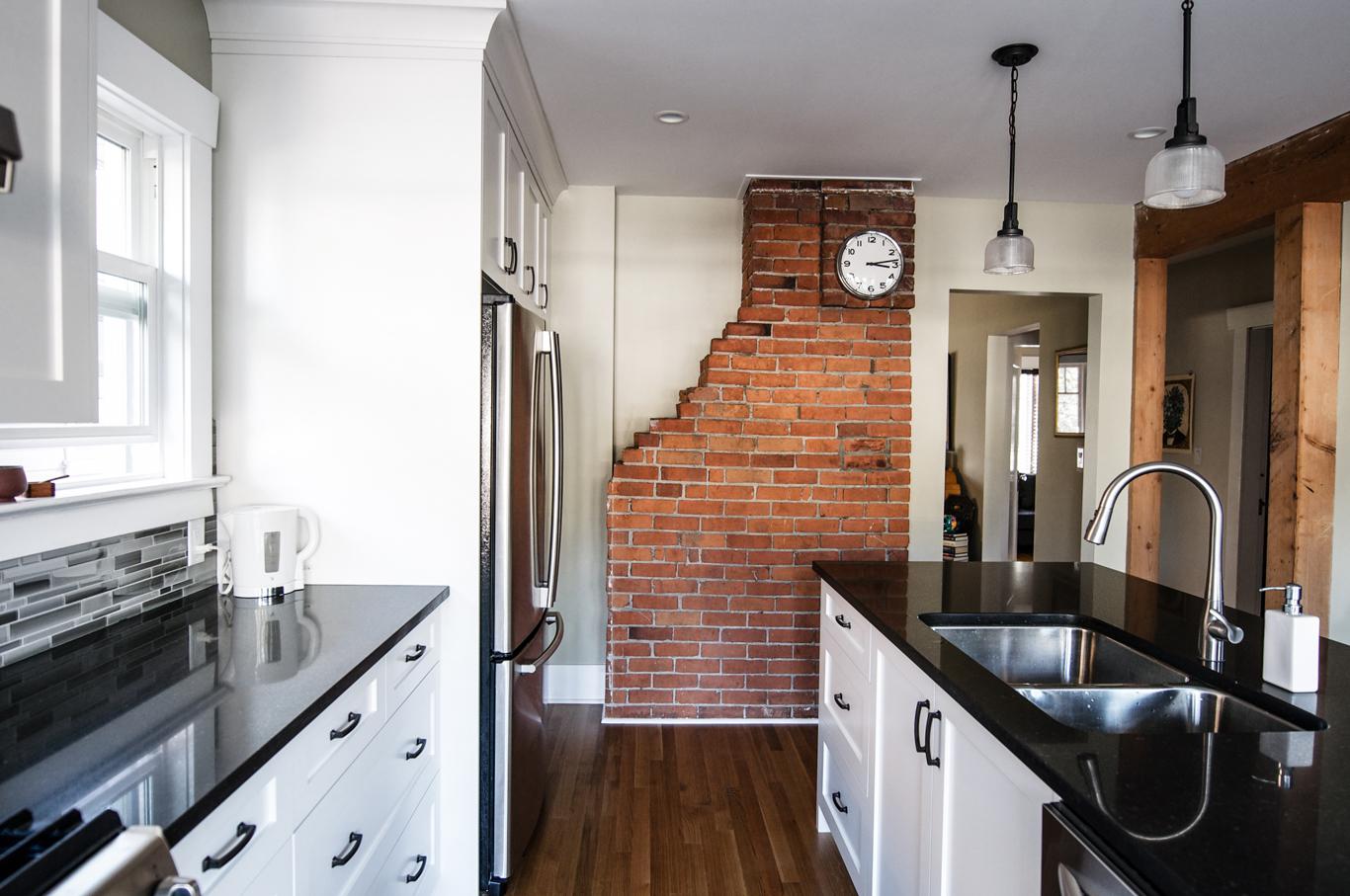 Wilson Kitchen - Modern and elegantly nostalgic - The timeless brick chimney highlights this kitchen renovation.