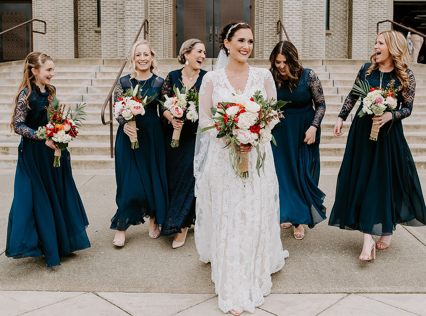 2. Bridesmaids should be dressed at least thirty minutes prior to the Bride.  All bridesmaids and mothers should be ready by the time the Bride puts on her dress. Added note: Consider asking mom and your maid of honor to assist with putting on your wedding dress. Then, reveal your final look to bridesmaids once you are in your Bridal Gown. This can alleviate too many cooks in the kitchen and make for a special moment between mom and daughter.