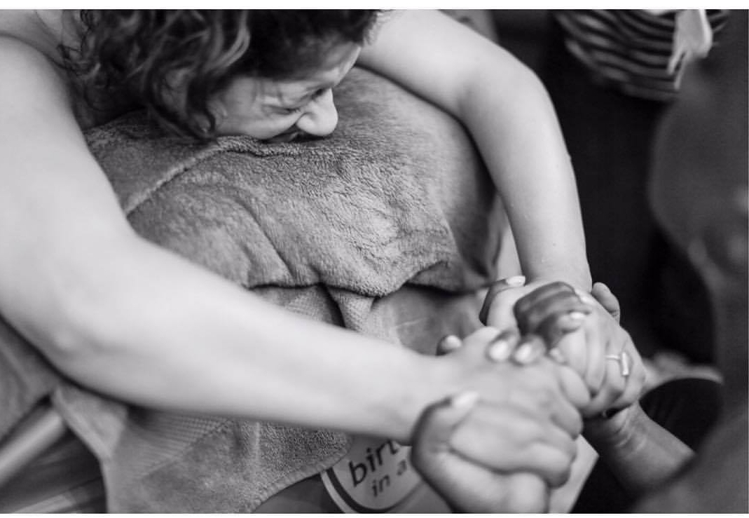 laboring woman being held by Jessica Diggs. (photo credit: Exposure World Photography)