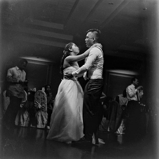Sharing love songs all night. Shot on medium format b&w film. #weddings #bwfilm #bwphotography #120mm #lubitel166b #singing #weddingcouple #love #weddingphoto