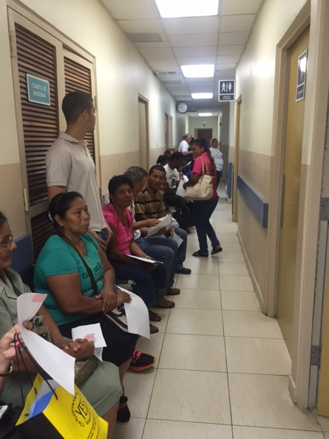 People patiently awaiting their visit with the Eye Doctor.