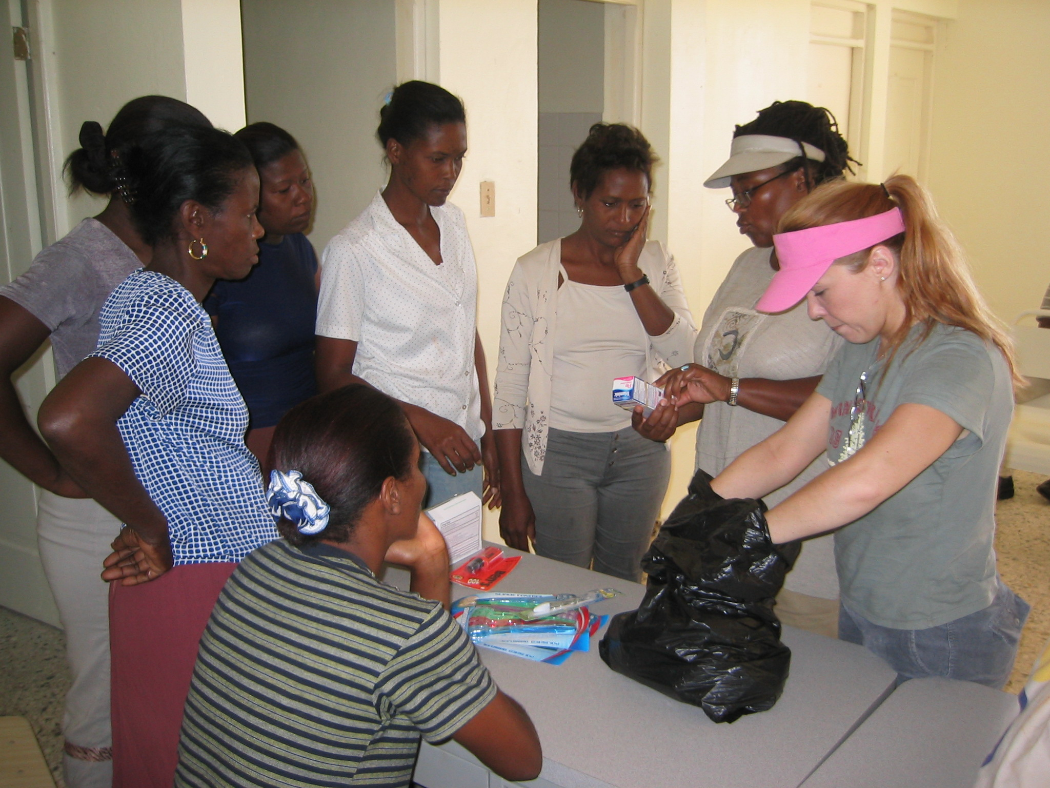 Volunteer helps to distribute donated medicines at the health clinic in nearby Altagracia