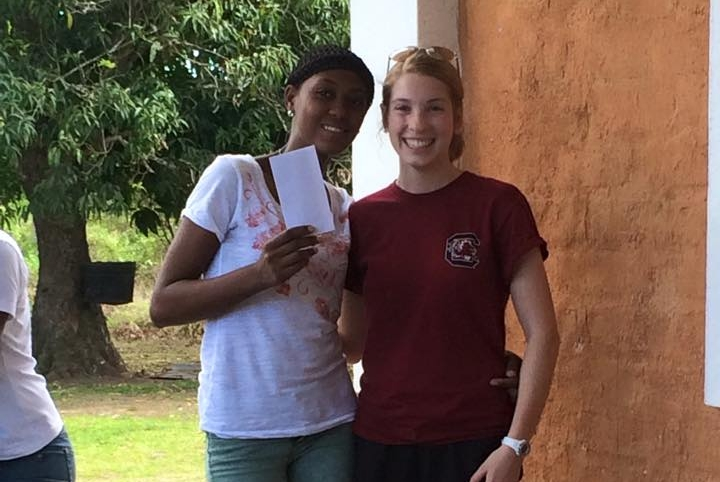 University scholarship recipient with volunteer who just participated in scholarship award distribution