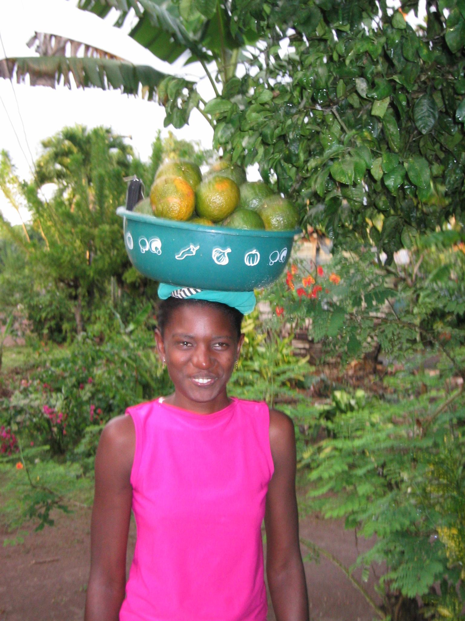 Young woman carrying fruit in Cruz Verde
