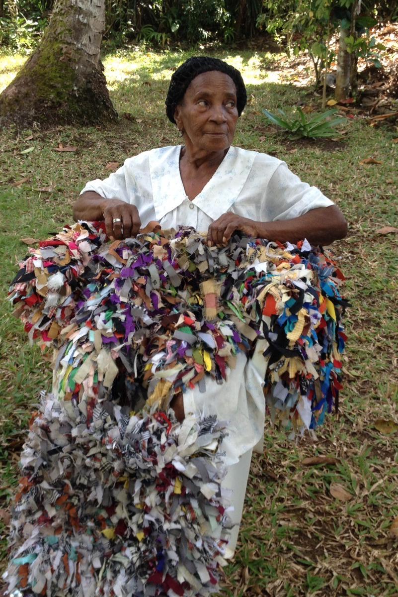 Juanita with woven rugs in Cruz Verde